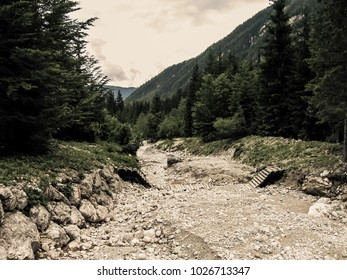 Collapsed bridge and dry riverbad