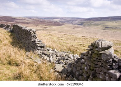 A collapsed drystone wall on Conistone Moor above Wharfedale, in the Yorkshire Dales National Park