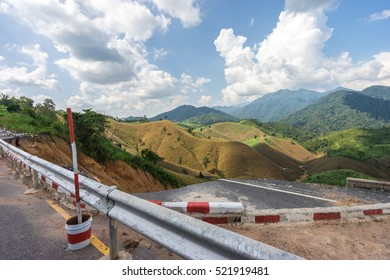 Collapsed road on beautiful romantic mountain route in Thailand, Along the rural road No.1081, Curve of road,tropical road in jungle, Scenic view. Road Landscape in Nan, Northern part Thailand
