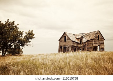A collapsing old house on the prairies.