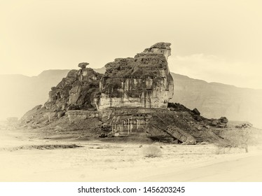 The collapsing stone remains of lava of ancient volcanic eruptions and sedimentary rocks. named Sphinx (Observer). Timna Park. Wadi El Aravah, Israel (stylized retro)