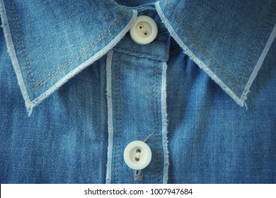 The collar, coat button and the seam of blue dress.
