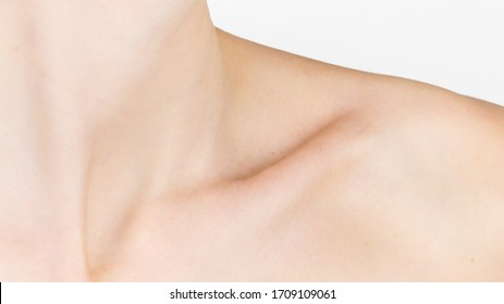 Collarbone. Detailed texture of human skin. Close up shot of a young caucasian female body. Skin care, body care, healthcare, hygiene and medicine. Nice and well maintained. Dermatology.
