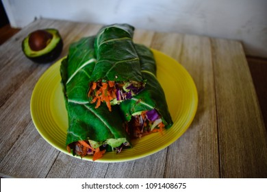 Collard Green Wraps with Black Bean Hummus, Avocado, Red Cabbage, Shredded Carrots and Cilantro