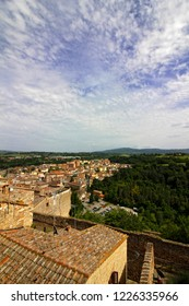 COLLE DI VAL D'ELSA, ITALY - 05/30/2018: Cityscape of Colle di Val d'Elsa from the old town on a sunny warm spring afternoon.