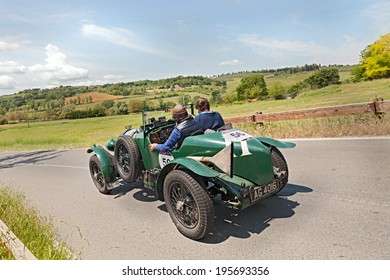 COLLE DI VAL D'ELSA, SI, ITALY - MAY 17: unidentified crew on a vintage sport car Bentley 4.5 Litre (1929) runs in historical rally Mille Miglia on May 17, 2014 in Colle di Val d'Elsa, Tuscany, Italy