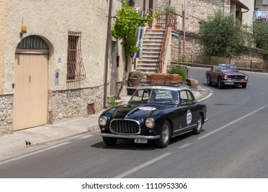 Colle di Val d'Elsa, Siena, Italy - May 17, 2014: driver and co-driver on a rare vintage car Ferrari 212 Inter Coupé Pinin Farina (1953) travels in Tuscany during the historical race Mille Miglia
