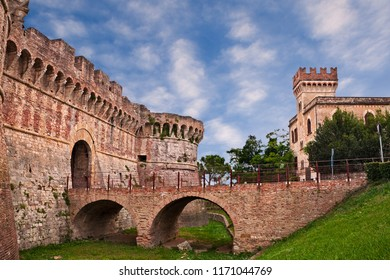 Colle di Val d'Elsa, Siena, Tuscany, Italy: the ancient city walls of the medieval fortress with moat, bridge and city gate at the entrance to the old town