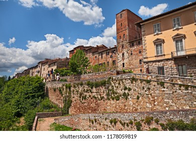 Colle di Val d'Elsa, Siena, Tuscany, Italy. View of the medieval town with city walls on the tuscan hill, with city walls