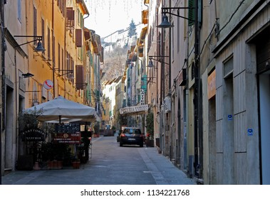 Colle Val d'Elsa, Tuscany/Italy - 01 07 2017: narrow cobbled street with pizzerias, trattorias and colourful buildings.