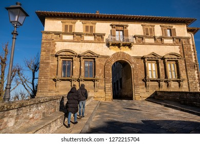 COLLE VALDELSA, ITALY - DECEMBER 26, 2018: Palazzo Campana, the gateway to the oldest part of the town of Colle Valdelsa, Siena, Tuscany