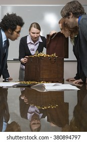 Colleagues around a treasure chest
