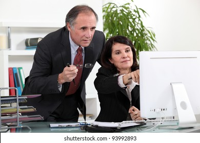Colleagues discussing a project