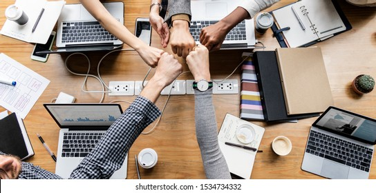 Colleagues giving a fist bump