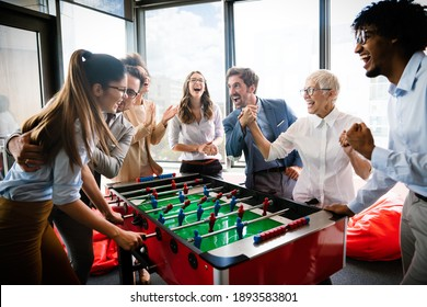 Colleagues playing table football in the break.