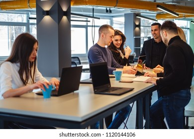 Colleagues smiling while working casually at the office meeting