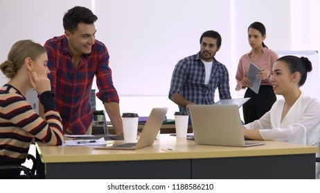 Colleagues talking while working in office with relax style.