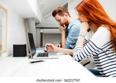 Colleagues working studying in white modern office