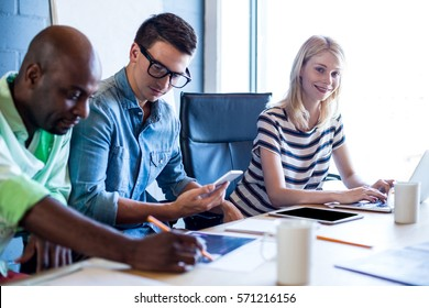 Colleagues working at their desk in the office