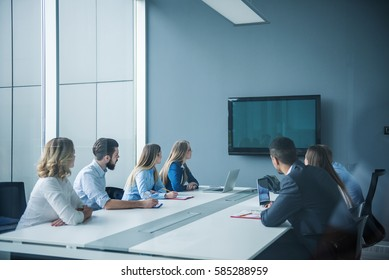 Colleagues working together in a conference room.