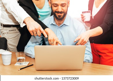 colleagues working together on a project using laptop