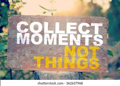 Collect moments no things text on old wooden