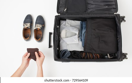 To collect things into a large black suitcase on a trip. An empty space to insert text.