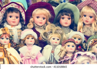 Collectible dolls, background. Toned