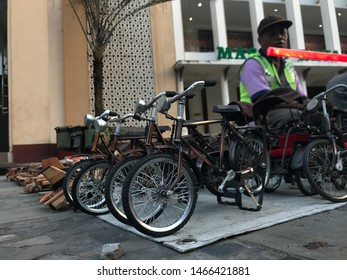 Collectible items of vintage bicycle, displayed on public street-side at merchants stall. Klaten, Indonesia - July 27, 2019.