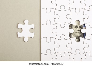 Collecting 100 dollars banknote with pieces of jigsaw puzzle. Concept of teamwork for sucsess.