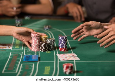 Collecting chips winning baccarat