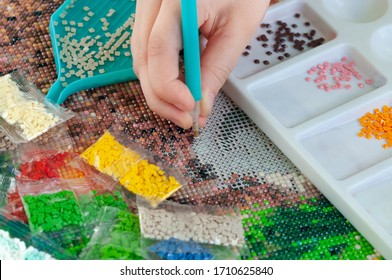 Collecting diamond embroidery, diamond mosaic. Colored crystals.