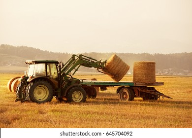 collecting hay bails