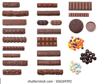 A collection of 25 chocolate candies shot from an overhead view isolated on white.