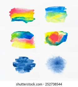 Collection of abstract colorful watercolor brushes on white paper background.