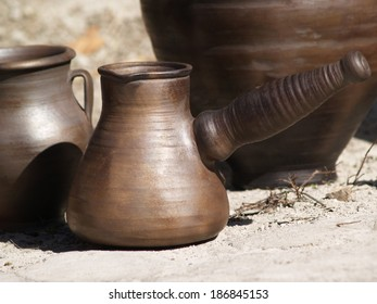 Collection of ancient clay dishes at sunny day