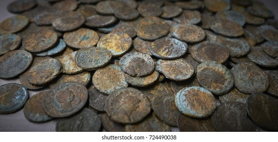 A collection of ancient Roman coins mainly of the Roman emperor Gallienus. Dated third century A.D. (1 of 2)