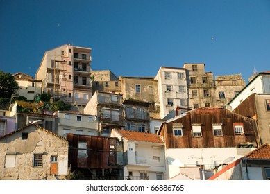 A collection of apartment buildings on the side of a hill in Porto, Portugal
