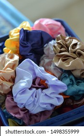 A collection of assorted hair scrunchies for wearing in your hair as ponytails or ties for fashion accessories