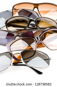 Collection of assorted styles of tinted sunglasses on white background