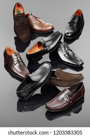 collection of assrted leather shoes for man on neutral background