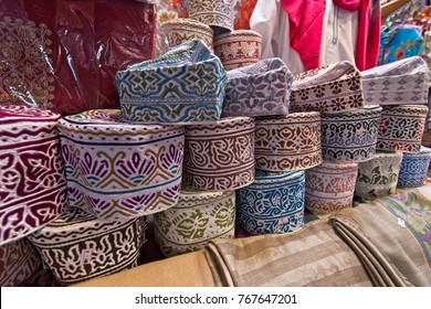 A collection of beautiful headdress or kumma for Omani men being sold at the Muttrah Souq, Oman.