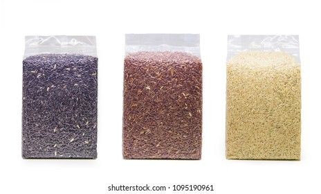 Collection Black rice, brown rice and white rice in transparent plastic bag isolated on white background. Packaging collection
