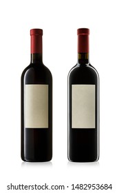 Collection of bottles of red wine on white background.