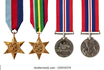 Collection of British and Australian World War II military medals, isolated on white.  Includes the 1939-1945 Star, the Pacific Star, and the Australian and British Service Medals.