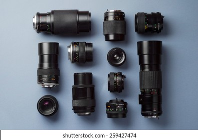 Collection of camera lens well organized over blue background