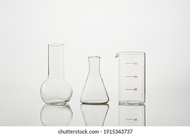 Collection of chemical glassware in laboratory on a white background. Test tubes and laboratory glassware for experiments.
