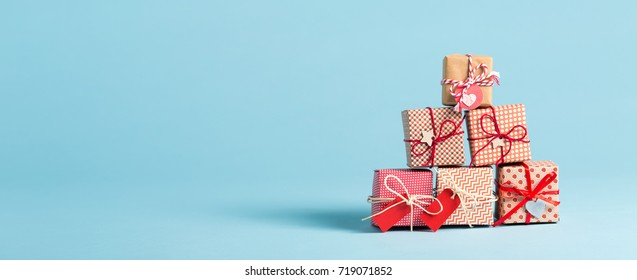 Collection of Christmas present boxes on a light blue background