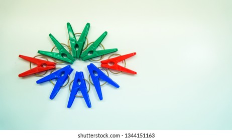 A collection of clothing clips that are circular with a white background