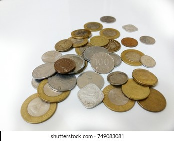 collection of coins of different coins with some old coins on a white background